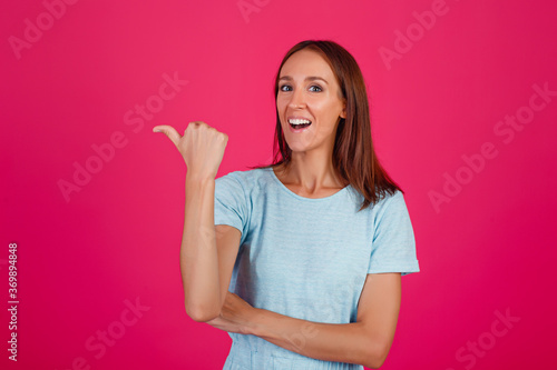 Fototapeta Close-up photo of an impressed lady showing hand gestures, wearing a blue t-shir