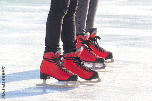 feet in red skates on an ice rink Fototapet