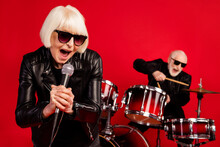 Portrait Of Two Retired Pensioner Retired People Woman Sing Composition Solo Man Play Drum Drumstick Enjoy Leisure Night Club Event Wear Leather Isolated Over Bright Shine Color Background