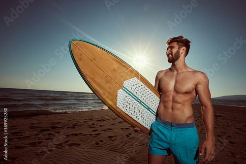 Obraz Sexy surfer posing on the beach - fototapety do salonu