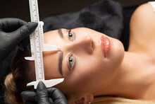 Woman In Gloves Preraring To The Permanent Makeup