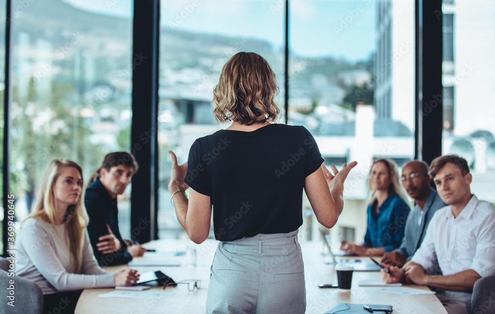 Fototapeta Businesswoman sharing new ideas in meeting