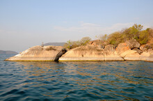 A Rocky Point Cutting Into The Blue Water Of Lake Malawi
