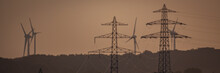 High-voltage Pylons And Wind T...