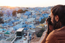 Tourist Makes A Photo Of Blue City