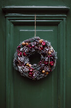 Christmas Wreath Of Branches On A Green Door