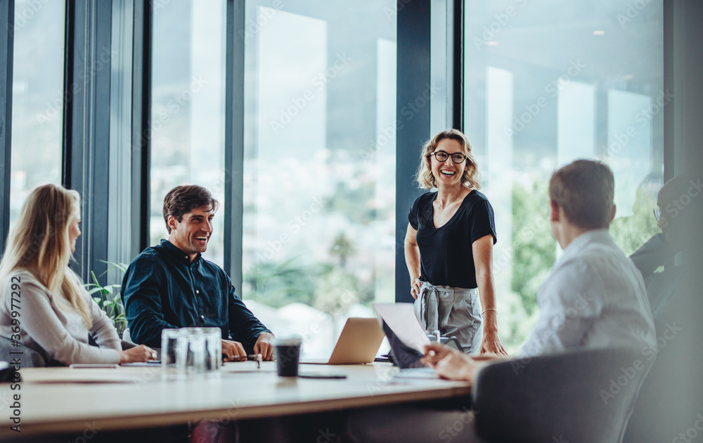 Fototapeta Business people having casual discussion during meeting