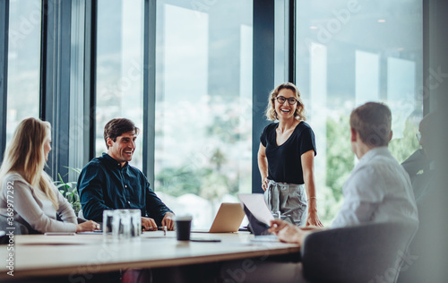 Obraz Business people having casual discussion during meeting - fototapety do salonu
