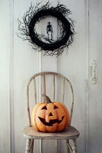 Large Pumpkin On Old Chair