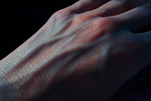 Hand With Blue Blood Veins In The Dark Closeup