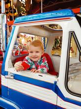 Cute Toddler In A Carousel Ride