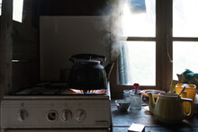 Old Kettle On The Gas Stove In...
