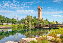Summer Day At Riverfront Park Showing The Clock Tower And Expo Pavilion Along The Spokane River In Downtown Spokane, Washington, USA.