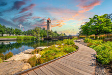 The Spokane Clock Tower And Pavilion Along The River In Riverfront Park, Downtown Washington, Under A Colorful Sunset In Spokane, Washington, USA
