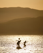 Silhouette Of Kids Playing In ...