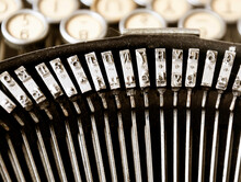 The Iron Hammers Of An Old Typewriter With The Keys Blurred In The Background. Typing And Obsolete Technology. Vintage Object