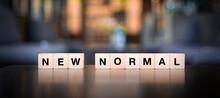 New Normal,word On Wooden Cubes, Affectation After Covid-19 Pandemic..