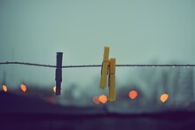 Clothespins On Wire With Raind...