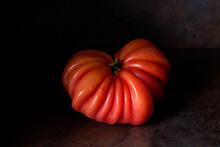 Isolated Red Tomato On Dark Ru...
