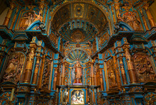 Chapel Interior In The Lima Metropolitan Cathedral With Virgin Mary And Baby, A Baroque Style Altar In Wood (blue And Gold Decorations), Lima, Peru.