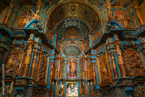 Chapel interior in the Lima Metropolitan Cathedral with Virgin Mary and baby, a baroque style altar in wood (blue and gold decorations), Lima, Peru Fototapeta