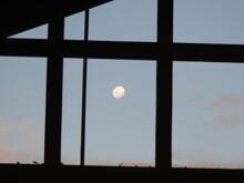 View Of Daylight Moon Through Window