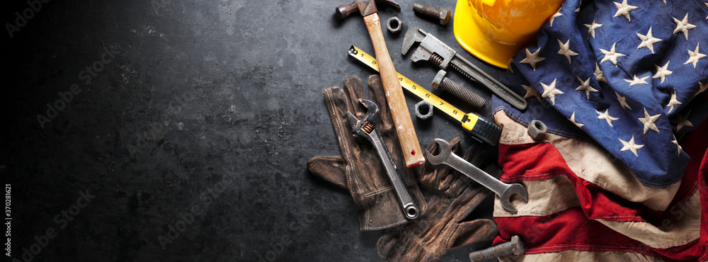 Fototapeta Construction and manufacturing tools with patriotic US, USA, American flag on dark black background