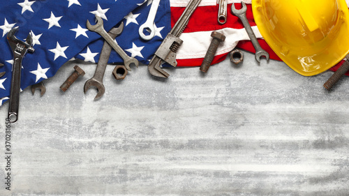 Foto Labor day or American labor concept with construction and manufacturing tools on