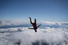 Skydivers Over Snowy Mountains...