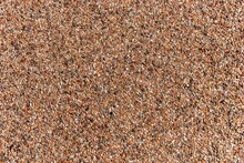The Pattern Of Dark Brown Small Pebbles As Background