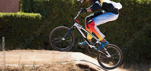 BMX rider competing in the child class on the off-road circuit