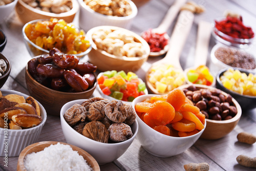 Fototapeta Composition with dried fruits and assorted nuts. Delicacies