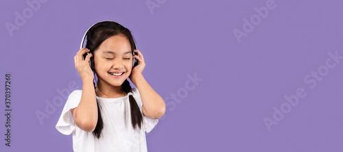 Obraz Asian Girl In Headphones Listening Music Standing In Studio, Panorama - fototapety do salonu