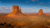 The sandstone formations of West Mitten Butte and East Mitten Butte in the desert landscape of Monument Valley Navajo Tribal Park in southern Utah, United States