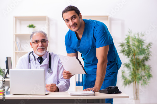 Two male doctors working in the clinic