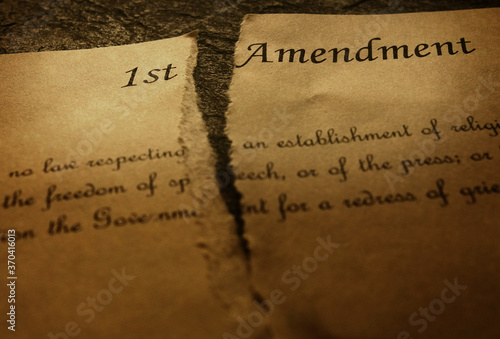 Photo The First Amendment of the US Constitution, torn in half