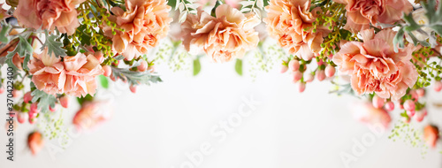 Autumn composition made of beautiful flowers on light backdrop. Floristic decoration. Natural floral background. #370422400