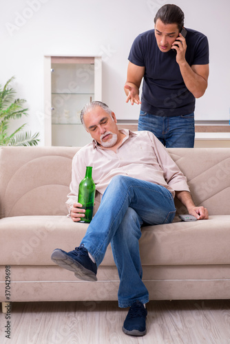 Man with drinking problem and the family Wallpaper Mural