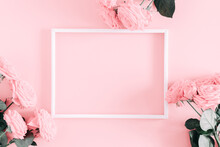 Beautiful Flowers Composition. Photo Frame, Pink Rose Flowers On Pastel Pink Background. Valentines Day, Easter, Birthday, Happy Women's Day, Mother's Day. Flat Lay, Top View, Copy Space