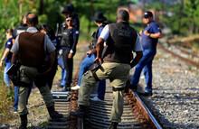 Salvador, Bahia / Brazil - November 23, 2015: Civil Police Investigators Are Investigating A Murdered Person Near The Suburban Train Line In The City Of Salvador.