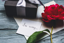 Gift Box And Letter With Text I'M SORRY On Wooden Background