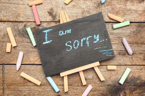 Obraz Chalkboard with text I AM SORRY on wooden background - fototapety do salonu