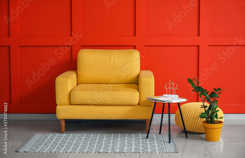 Modern armchair in interior of room
