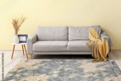 Obraz Interior of modern room with sofa and beautiful carpet - fototapety do salonu