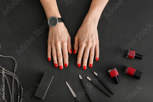 Obraz Hands and tools for manicure on dark background - fototapety do salonu