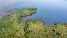 Drone Bird's Eye View Landscape Image Of Tidal Wetlands In Christchurch Harbour On England's South Coast