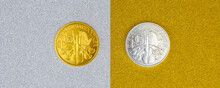 Silver And Golden Austrian Mint Phillharmoniker One Ounce Coins Laying On Silver And Golden Background.