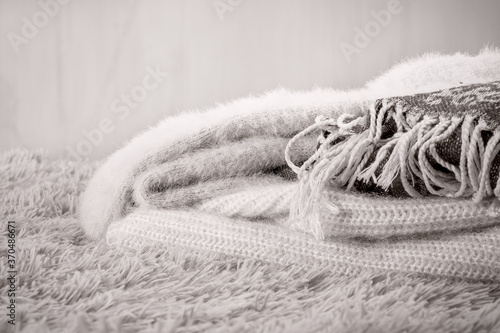 Fototapeta Cozy home, warm knitted wool clothes.
