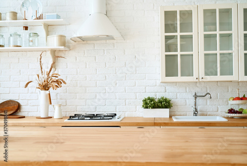 Kitchen wooden table top and kitchen blur background interior style scandinavian Fototapete