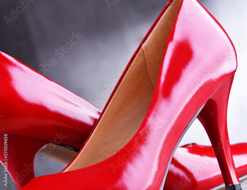 Fototapeta Composition with a pair of red high heel shoes obraz